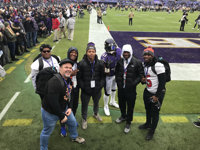 Watkins Mill varsity football players Baebaa Sayeh, Kyle Wingate, Demetrius Rush, Alfred Koiwood Jr, Darrious Ellis, and coach Charles Miller  with ravens defensive back Anthony Levine Sr.