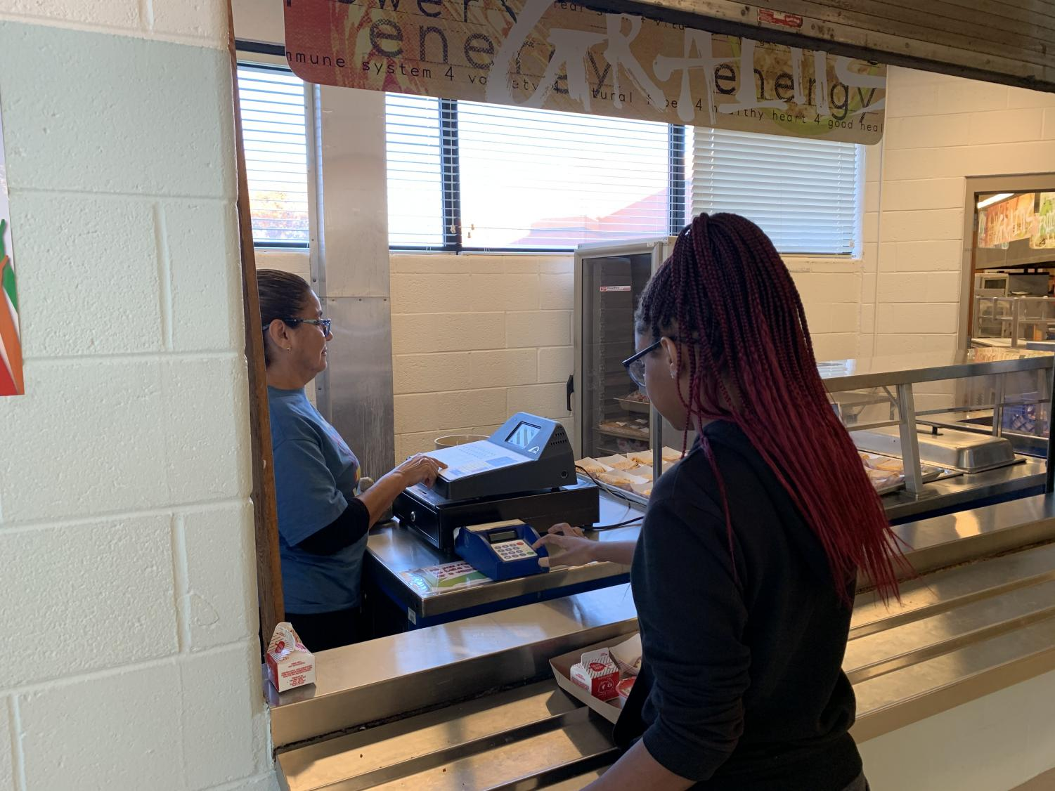 Freshman Destiny Hyman checks out at the after-school supper program, which is available to all students participating in Rec Zone or other extracurricular activities.