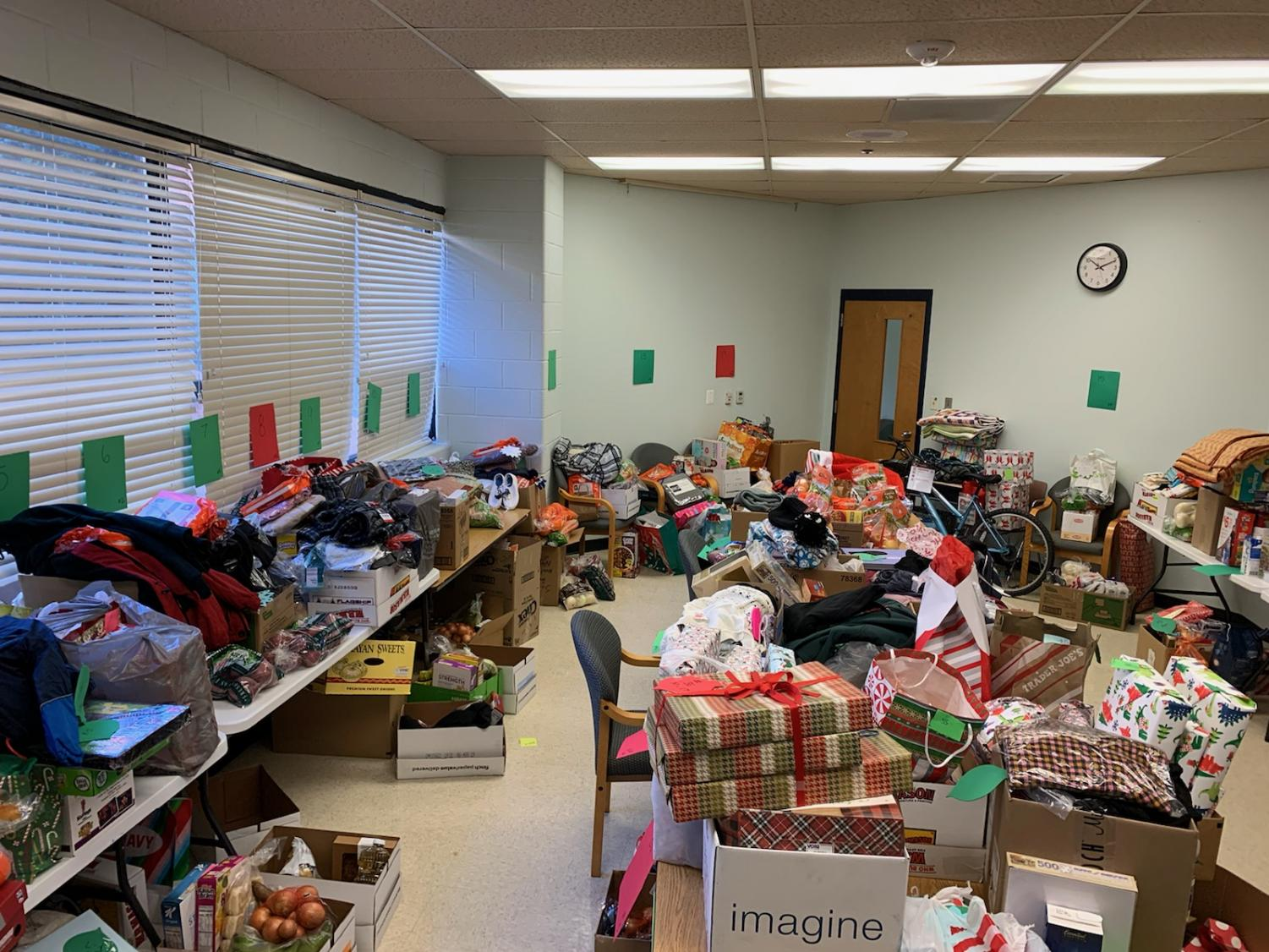 Presents and canned foods prepared for families in need during the holidays at Watkins Mill High School.