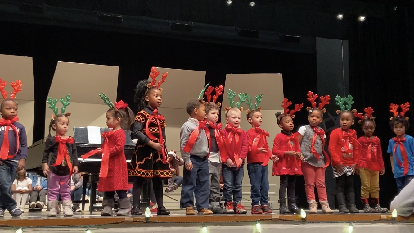 Child Development preschoolers singing at their winter concert.