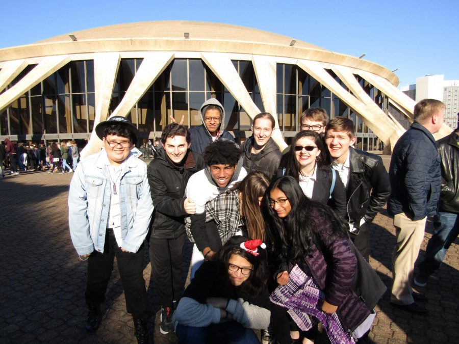 Students posing for a picture, outside the Norfolk Scope Arena before the show