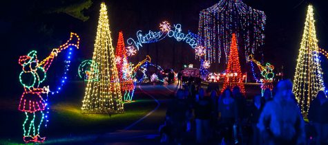 Montgomery County residents taking a walk through the Winter Lights Festival.