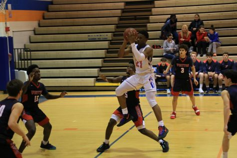 The boys basketball team faced off against Wooten High School.