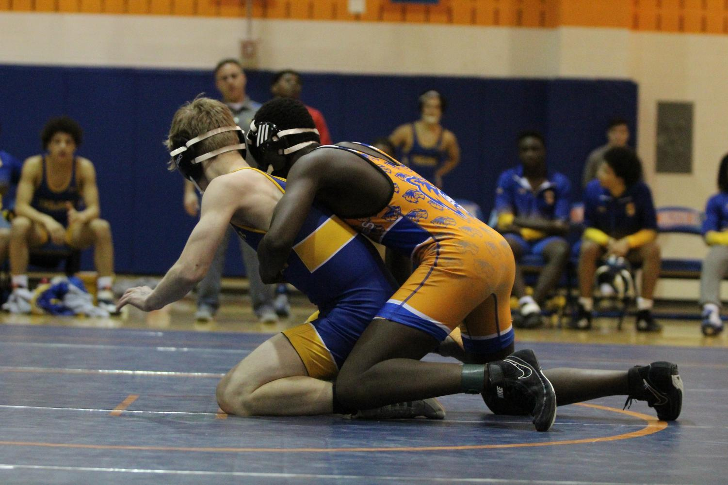 The Watkins Mill High School Wolverines defeated the Gaithersburg High School Trojans in a wrestling match on January 28.
