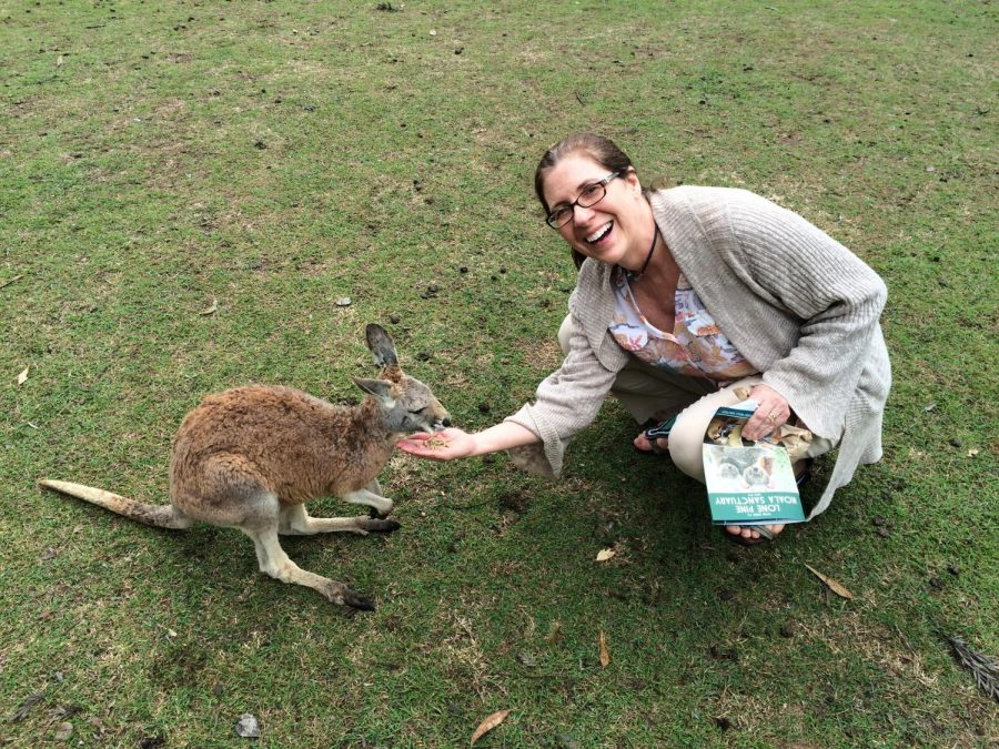 English resource teacher Julie Dean feeds a baby kangaroo while in Australia. Dean has lived in five foreign countries because of her husband