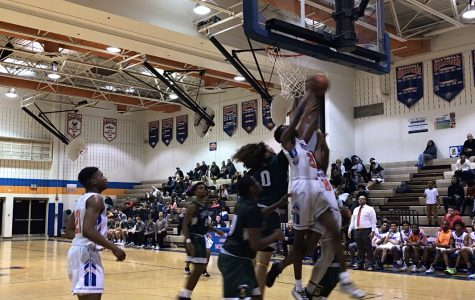 Watkins Mill High School's Wolverines face off against Damascus High School on January 15.