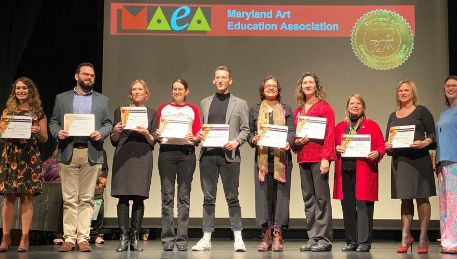 Art teacher John Ward with other honorees receiving the Art Educator of the Year award.