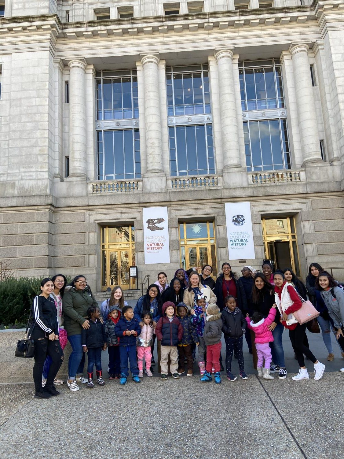 Child Development preschoolers, high school students and teacher Melissa Cloyd outside the Smithsonian National Museum of Natural History.