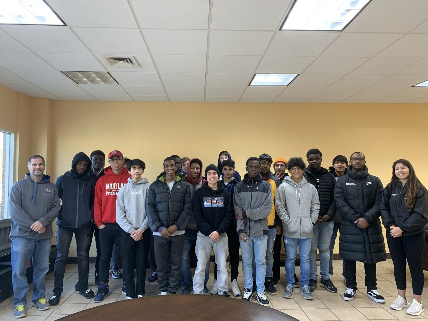 Men of ELITES posing for a picture after taking a visit to A Wider Circle in Silver Spring MD
