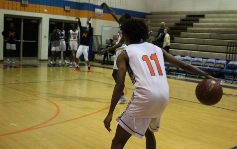 Senior Jaylen Stephens warms up for a game against Poolesville High School.