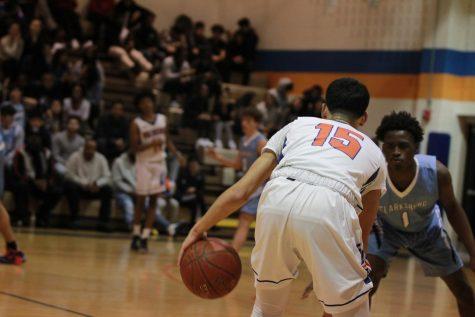 Junior Joseph Crespo dribbles the ball around a Clarksburg High School player.