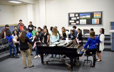Social studies resource teacher Lauren Squier talks to prospective and current students about Watkins Mill High School.