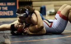 Junior captain Seda Tsarni pins her opponent in the wrestling match against Albert Einstein High School
