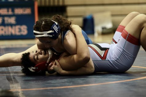 Junior captain Seda Tsarni pins her opponent in the wrestling match against Albert Einstein High School