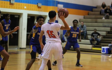 Junior Joseph Crespo passes the ball to a teammate as Gaithersburg players move in on him.