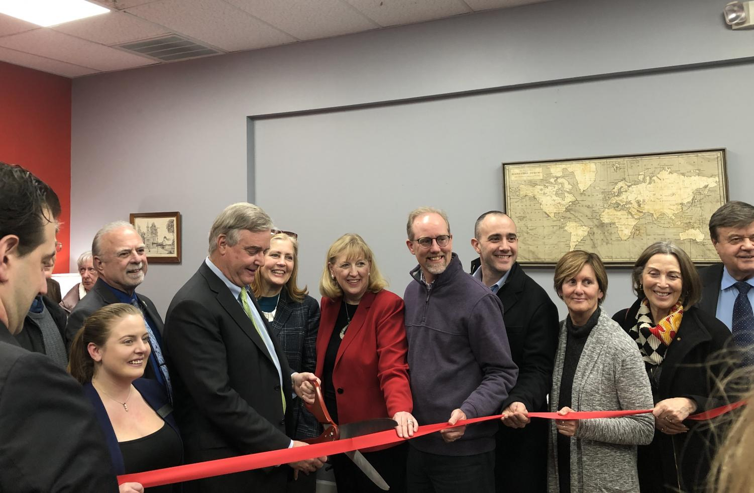 Rep David Trone cutting the ribbon at his Frederick District Office opening.
