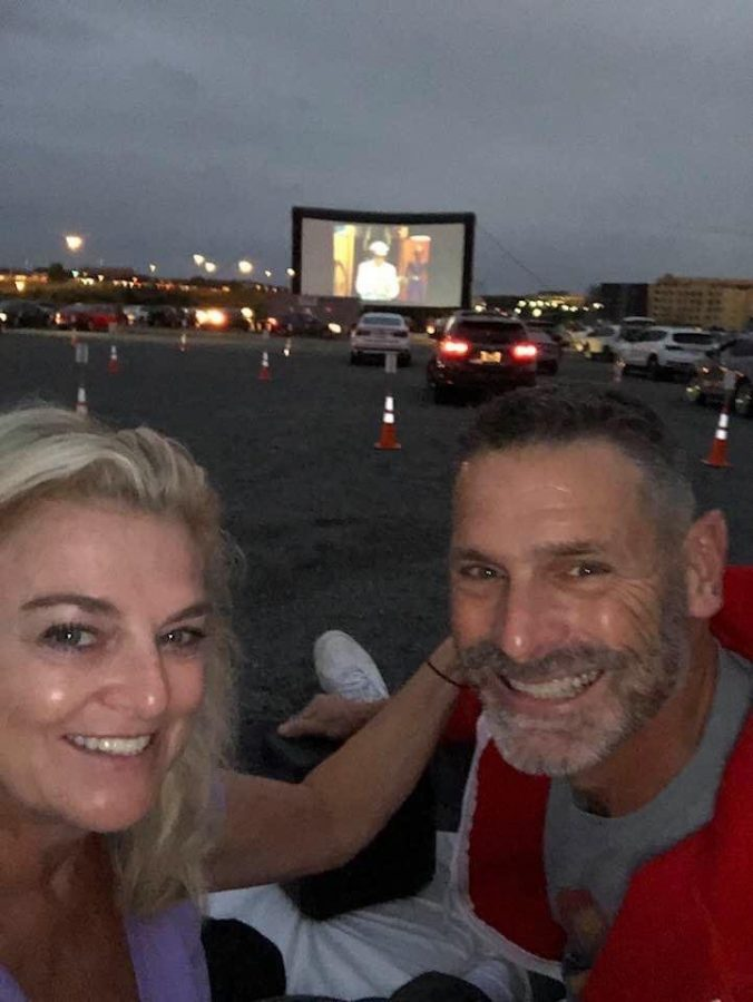 Media Specialist Anamaria Mitton enjoys a drive-in movie with her husband Bob Mitton at Rockville