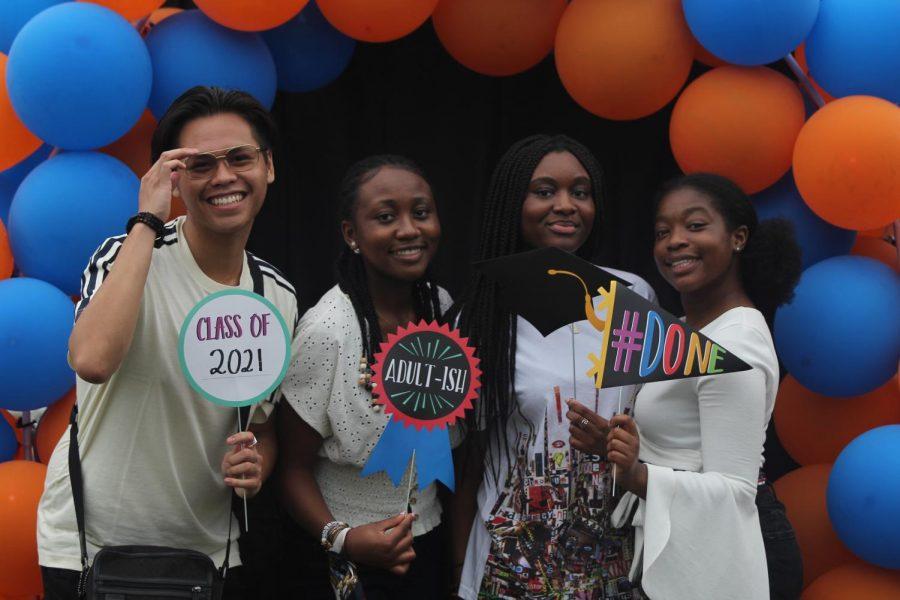 Seniors Francisco Carbonell, Comfort Oshagbemi, Asnath Balilonoso, and Aichatou Adamou at their senior celebration.