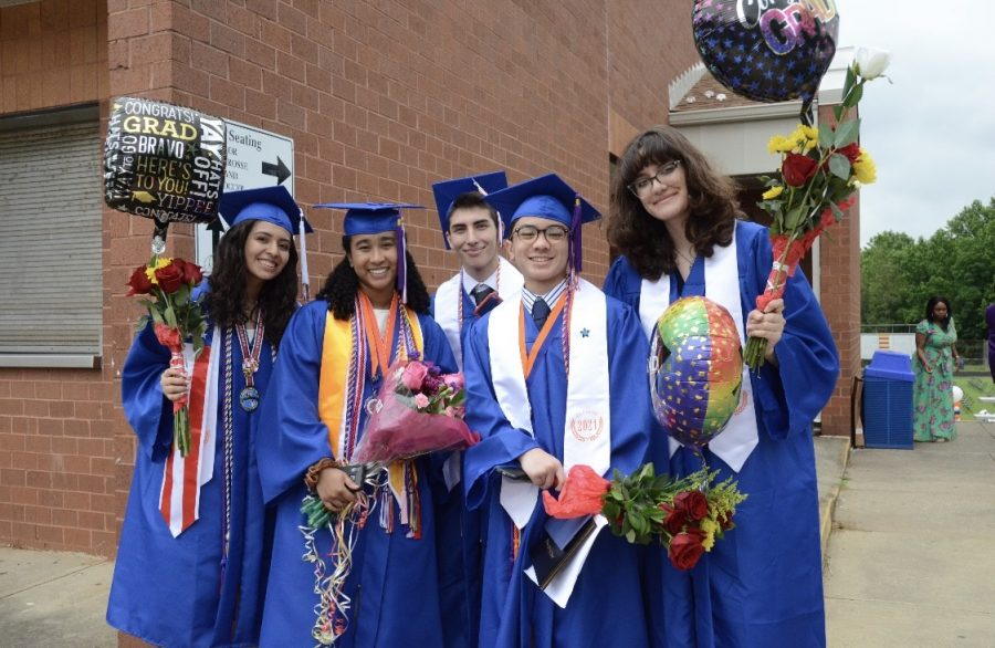 Seniors Jennifer Mangandi Sibrian, Grace Edwards, Benicio Walton, Rhamzy Achmad, and Vanessa Navarrete posing for a picture after graduation.