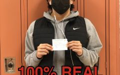 Michael Quintanilla poses with a totally real vaccination card, absolutely real, with nothing suspicious about it at all.
