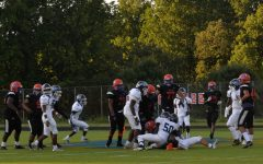 Watkins Mill football team has possession of the ball during the down against Springbrook.