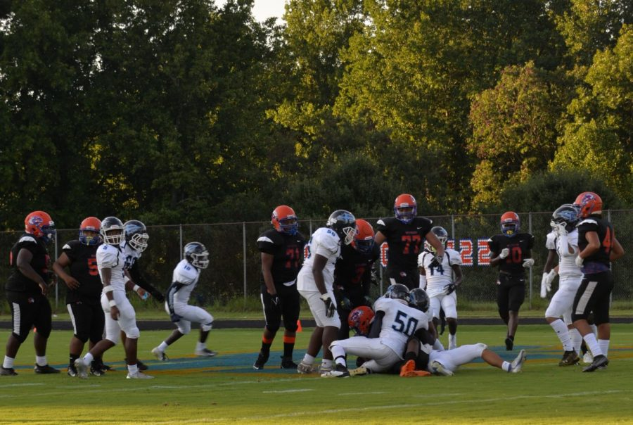 Watkins+Mill+football+team+has+possession+of+the+ball+during+the+down+against+Springbrook.+