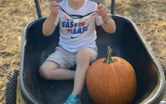 Friends of all ages enjoy picking pumpkins at local patches as a fun fall activity
