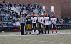 Varsity captains Muna Darlington #3, Devin Breckenridge #2, Kamarr Louissaint #10, and Brian Awisome #5 (left to right)