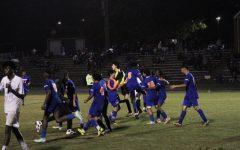 Junior Varsity Boys Soccer celebrates a 3-2 win over Magruder (Julien Payen)